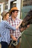 Stalla del cowgirl del cowboy Fotografia Stock