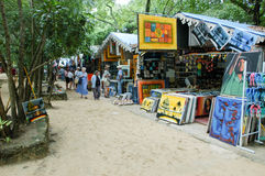 Stalls with colorful souvenirs at Sosua, Dominican Republic. Sosua, Dominican Republic - 16 january 2002: People shopping on the stalls with colorful souvenirs Royalty Free Stock Photography