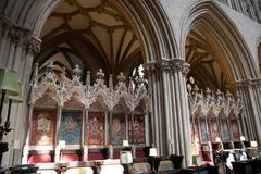 Wells cathedral choir stalls. The stalls in the Quire of Wells cathedral Royalty Free Stock Photo