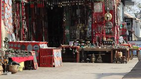 Stalls with souvenirs. Typical Asian  gift shop and black cat under the stall stock footage
