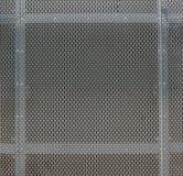 Stalowi prześcieradła z tysiącami owalne dziury ochraniają ventilatio obrazy royalty free