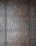Stalowy metal zbroi tło z nitami Fotografia Royalty Free