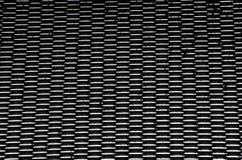 Stalowy tło Owalny dziura wzór w czarnym kolorze zdjęcia stock
