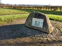 Stamford Bridge Battle Commemoration Stone. Stamford Bridge is in the East Riding of Yorkshire and was the venue of the famous battle in 1066. Here is the rock stock photo