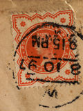 Stamp. Franked victorian postage stamp on paper Royalty Free Stock Image