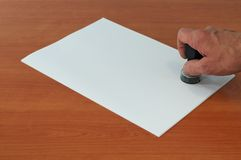 Stamp. On a blank white sheet of paper Stock Photo