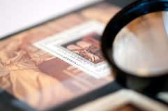 Stamp album. Reminiscing about stamp collections above a stamp album Stock Images