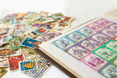 Stamp album with postage stamps. On white background royalty free stock photo