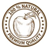 Stamp with the apple. And the text 100% natural, premium quality Royalty Free Stock Photo