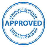 Stamp of approval. Approved stamped in blue text on white background in a circle Stock Images
