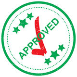 Stamp of approval. Text 'approved' in green uppercase letters inscribed on a circular (rubber) stamp with three stars above and below and a red tick placed Royalty Free Stock Image