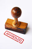Stamp approved. A photo of wooden stamp and approved stamp against white background royalty free stock image