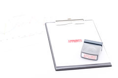 Stamp approved on clipboard. Royalty Free Stock Images