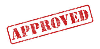 Stamp Approved. A red stamp with an approved insulated red background stock photos