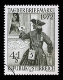 Stamp from Austria illustrating Day of Post Stamp. The postman brought the lady a letter. A stamp from Austria illustrating Day of Post Stamp. The postman Stock Photo