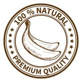Stamp with the banana. And the text 100% natural, premium quality Stock Photography