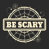 Stamp with Be Scary text. And spider net. Round shape Stock Photos