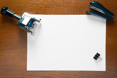 Stamp and a blank sheet of paper on an office desk Stock Photography