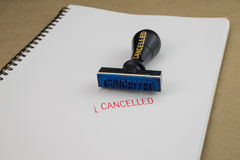 Stamp with Cancelled on white paper. Stamp with Cancelled red color on white paper Royalty Free Stock Photo