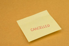 Stamp cancelled on yellow post it note. Stamp cancelled red color on yellow post it note Stock Image