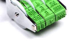 Stamp closeup. An office stamp with date Royalty Free Stock Images