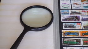 Stamp collecting stock video footage