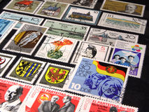 Stamp collection. Arranged postal stamps varied and colorful; clean, crisp stock photo