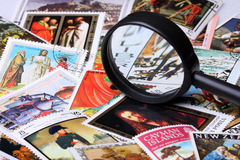 Stamp collection. With magnifying glass, shallow depth of field stock photography