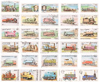 Stamp Collection: Steam Locomotives. Thirty different used stamps of old steam locomotives. Isolated on white royalty free stock photo