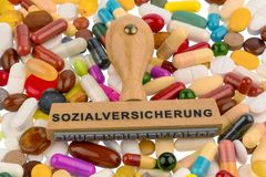 Stamp on colorful tablets. Symbolfot for social security, drugs and reimbursement Stock Image