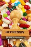 Stamp on colorful tablets. Symbolic photo for depression, therapy and psychotropic drugs stock image