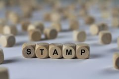 Stamp - cube with letters, sign with wooden cubes. Series of images: cube with letters, sign with wooden cubes stock images