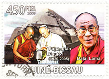 Stamp with Dalai Lama and Papa Paul II Royalty Free Stock Photos