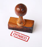 Stamp denied. A photo of wooden stamp and denied stamp against white background royalty free stock photography