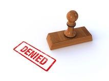 Stamp denied. 3d render of a rubber stamp showing denied Stock Images
