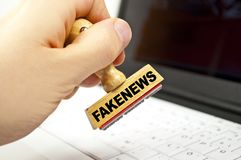 Stamp with fakenews. On a keyboard royalty free stock images