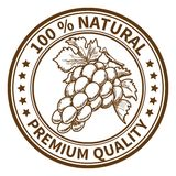 Stamp with the grape. And the text 100% natural, premium quality Royalty Free Stock Photography