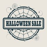 Stamp with Halloween Sale text. And spider net. Round shape Royalty Free Stock Photo