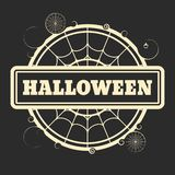 Stamp with Halloween text. And spider net. Round shape Royalty Free Stock Image
