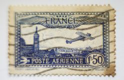 WORLD VINTAGE STAMP FRANCE, FINE GRAFICS. This stamp illustrates the first flights with a biplanese plane, flying over Paris Stock Photo