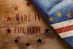 Stamp imprint of Made in Cape Verde. On a wooden background stock photos