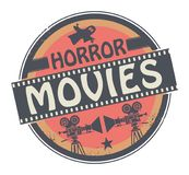 Stamp or label withtext Horror Movies. Stamp or label with movie projector, filmstrip and the text Horror Movies written inside, vector illustration vector illustration