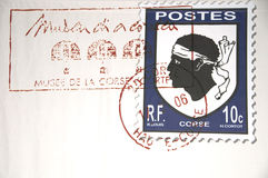 Stamp on a letter. A stamp on a letter from Corsica Stock Photos