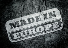 Stamp with made in Europe text over grunge background Stock Photos