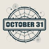 Stamp with October 31 text. And spider net. Round shape Stock Photography