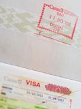 Stamp in passport. Canadian stam with visa in a passport Royalty Free Stock Photo