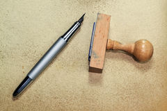 Stamp and pen Stock Photos