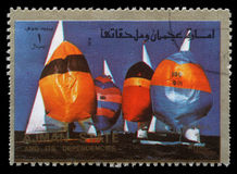 Stamp printed in the Ajman shows Sailing, Summer Olympics Royalty Free Stock Photos