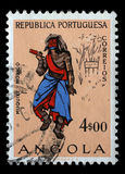 Stamp printed in the Angola shows Natives, Angolans Muquixe Stock Photo