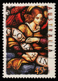 Stamp printed in Australia shows Angel with Gloria in excelsis Deo Banner. Circa 1995 Royalty Free Stock Photos